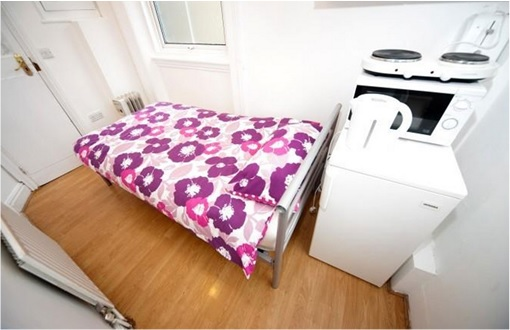 UK Smallest Tiniest House - bedroom, kitchen and shower are in one room on Earl Court Road