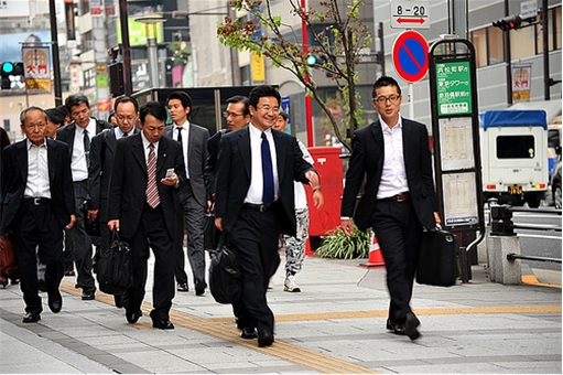 Chinese Businessmen Walking on Street