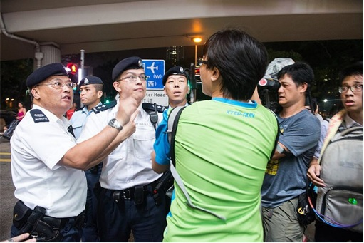 Hong Kong police's gestures seemed to be warning the journalists not to report anything bad