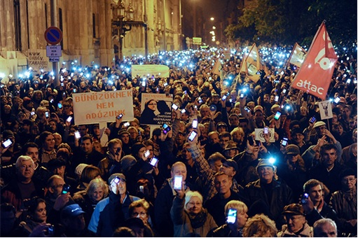 Hungary Internet Tax Protest - Protesters Flashing Smartphone