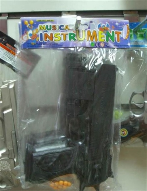Product Packaging Fails - Musical Instrument as Gun