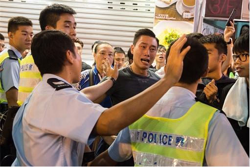 This protester was seen crying and heart-broken the Hong Kong police was not interested in arresting the thugs