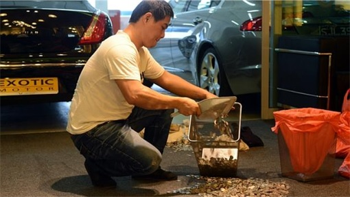Coins Smelled of Fish on Exotic Motor Carpet - Worker Scooping Coins - 2
