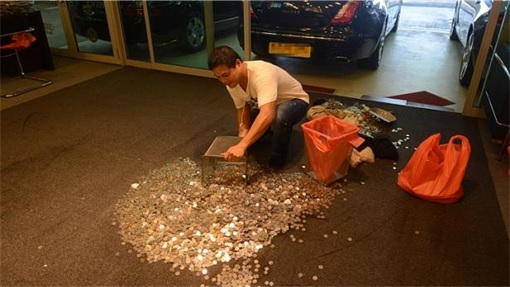 Coins Smelled of Fish on Exotic Motor Carpet - Worker Scooping Coins