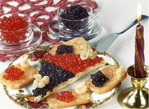 Russian Beluga Caviar spread on biscuits