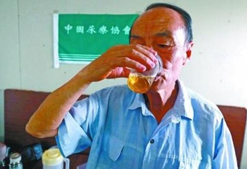 China - Man Drinking Urine