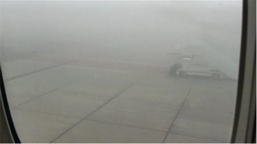 Etihad Airways Flight 183 stranded at Abu Dhabi Airport - Fog