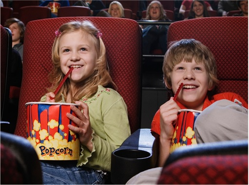 Kids Enjoying Watching Movie in Theatre