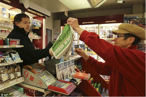 Parisians Queue for First Issue of Charlie Hebdo since the attack - inside shop
