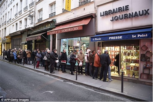 Parisians Queue for First Issue of Charlie Hebdo since the attack - outside shop