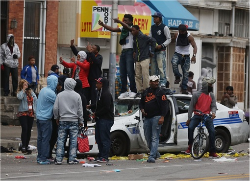 Baltimore Riots - Rioters on a Destroyed Police Car