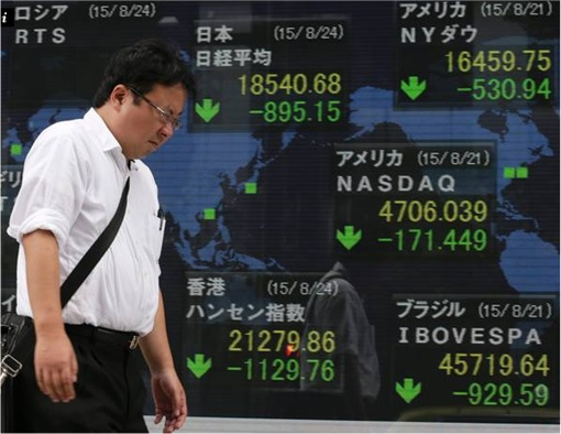China Black Monday - Dejected Investor with Stocks Down Screen