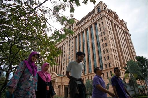 People Walking Passing Bursa Malaysia Building