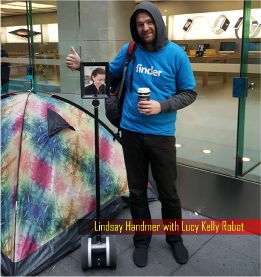 Lucy Kelly The Robot Waiting in Queue To Buy iPhone6S - Sydney Australia - With First in Line Lindsay Handmer