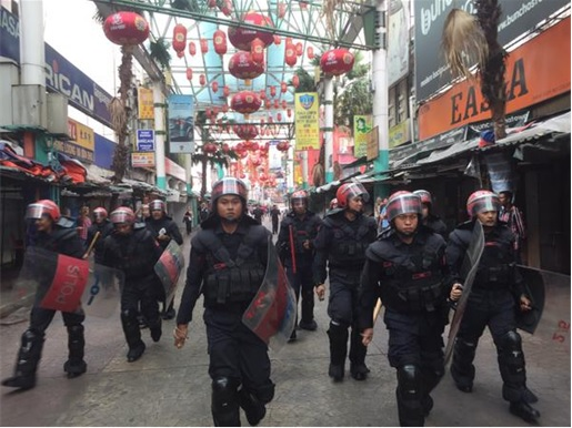 UMNO Red Shirts Rally - Riot Police Walking in Petaling Street Chinatown