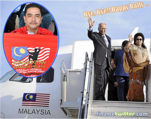 UMNO Red Shirts Supporter Holding T-Shirt - Najib and Rosmah Fly Away