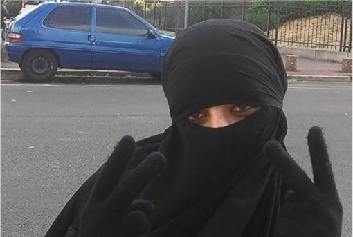 Paris Saint-Denis RAID - Hasna Aitboulahcen Suicide Bomber - Wearing Veil with Two V Signs