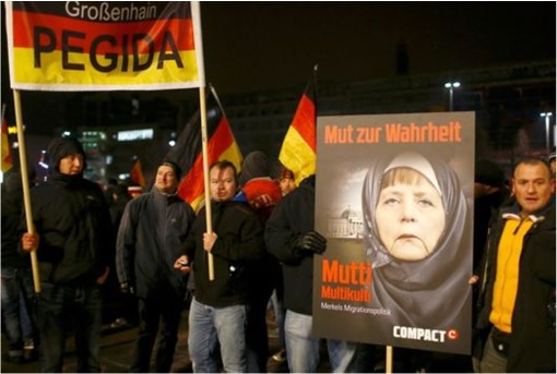 Syrian Refugee Protest by PEGIDA - Chancellor Merkel Wears Hijab