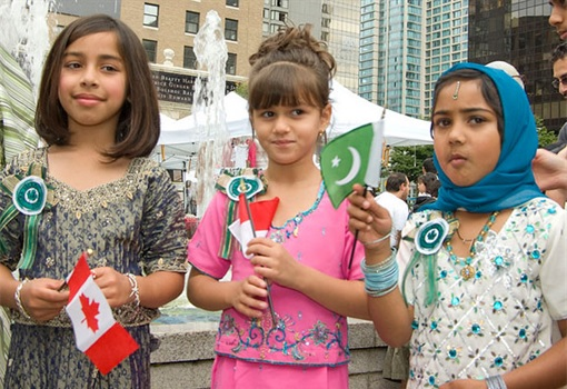 Kids with Canada and Pakistan Flags