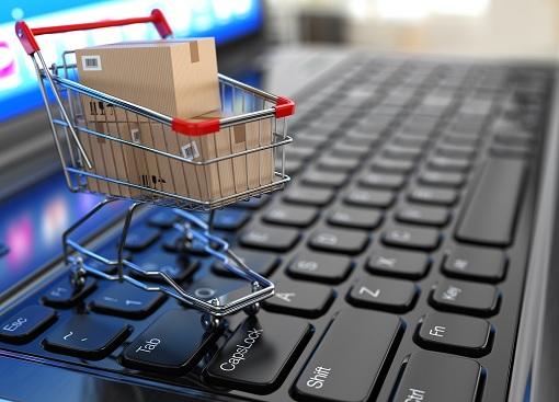 Make Money E-Commerce - Trolley on Keyboard