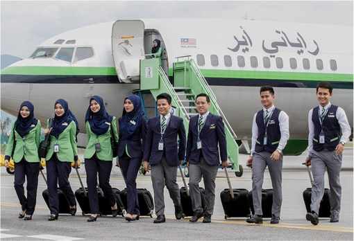 Rayani Air Crew Walking in front of Plane