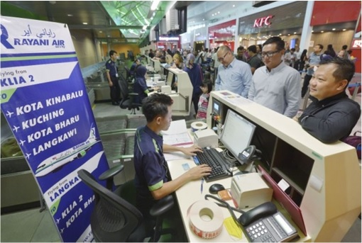 Rayani Air - Customers Check In At Counter
