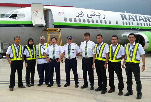 Rayani Air Pilot and Maintenance Crew in front of Plane