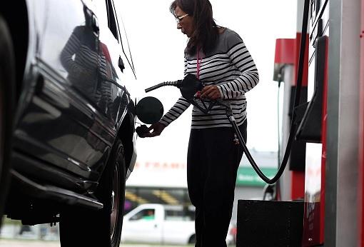 American Consumer Pumping Gasoline