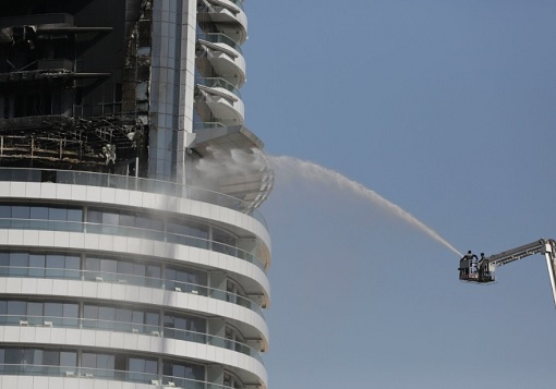 Dubai The Address Hotel on Fire - Firefighter in Crane Outside of Hotel