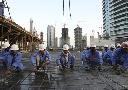 Foreign Construction Workers Building Dubai Skyscrapers