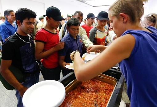 German Volunteers Feeding Food to Syrian Refugees
