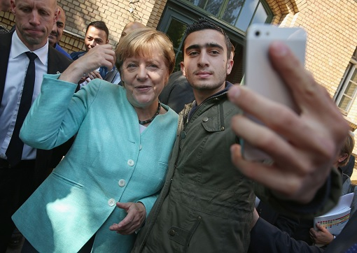 Germany Chancellor Angela Merkel Selfie with Syrian Refugee