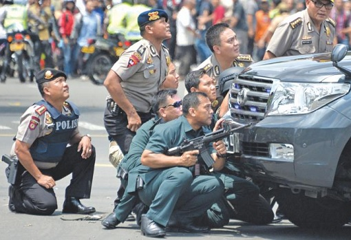 Jakarta Terrorist Attack - Police Defending Behind Toyota