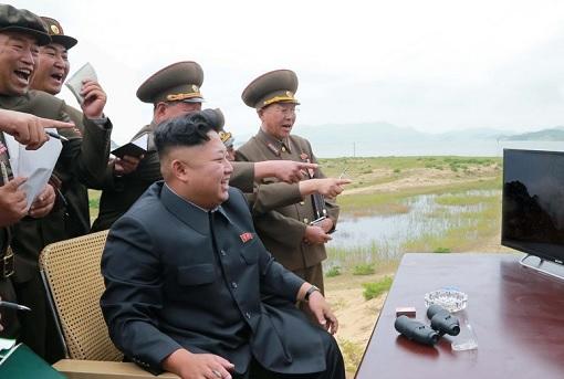 North Korea Kim Jong-un Laugh With Military Looking at Computer Screen