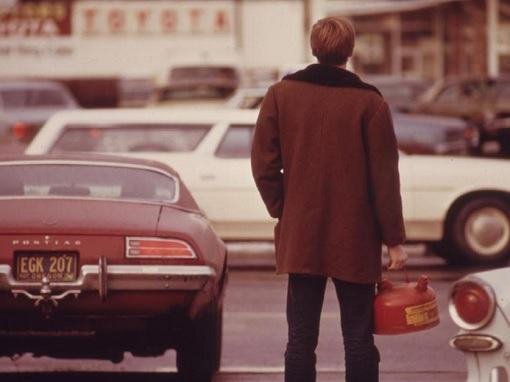 Oil Embargo 1973 by OPEC - American with Canister Waiting for Gas