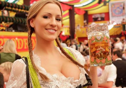 Sexy German Girl Holding Mug of Beer