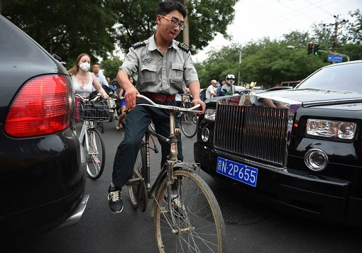 China Has Most Billionaires - Cyclist Navigate Rolls Royce