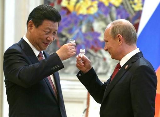 Russian President Vladimir Putin toasting Chinese President Xi Jinping