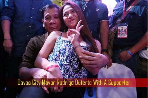 Davao City Mayor Rodrigo Duterte With A Supporter