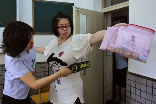 China Gaokao Exam - Scanning Students With Metal Detector For Metal Bras