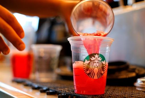 Starbucks Barista Pouring Drink