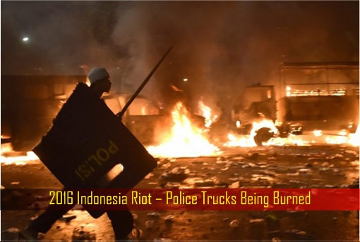 2016-indonesia-riot-police-trucks-being-burned
