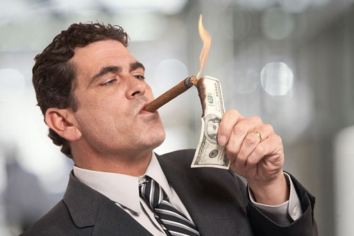 capitalism-and-globalism-burning-dollar-note-on-cigar
