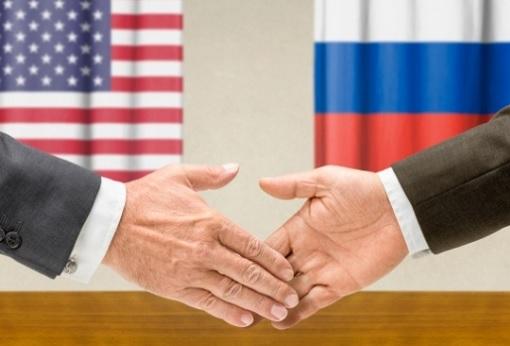 us-and-russia-cooperation-handshake