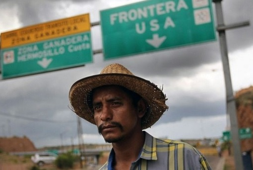 illegal-mexican-migrant-at-sign-board