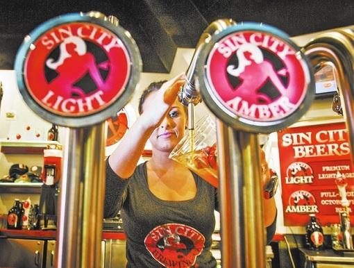 Las Vegas Sin City - Bartender Pumping Beer