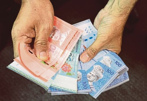 malaysia-corruption-offering-money