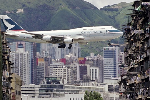 Cathay Pacific Plane Flies Over Kowloon