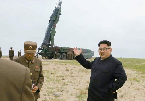 North Korea Kim Jong-un Smiling at Ballistic Missile