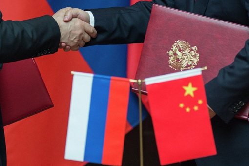 China-Russia Alliance - Handshake and Flags